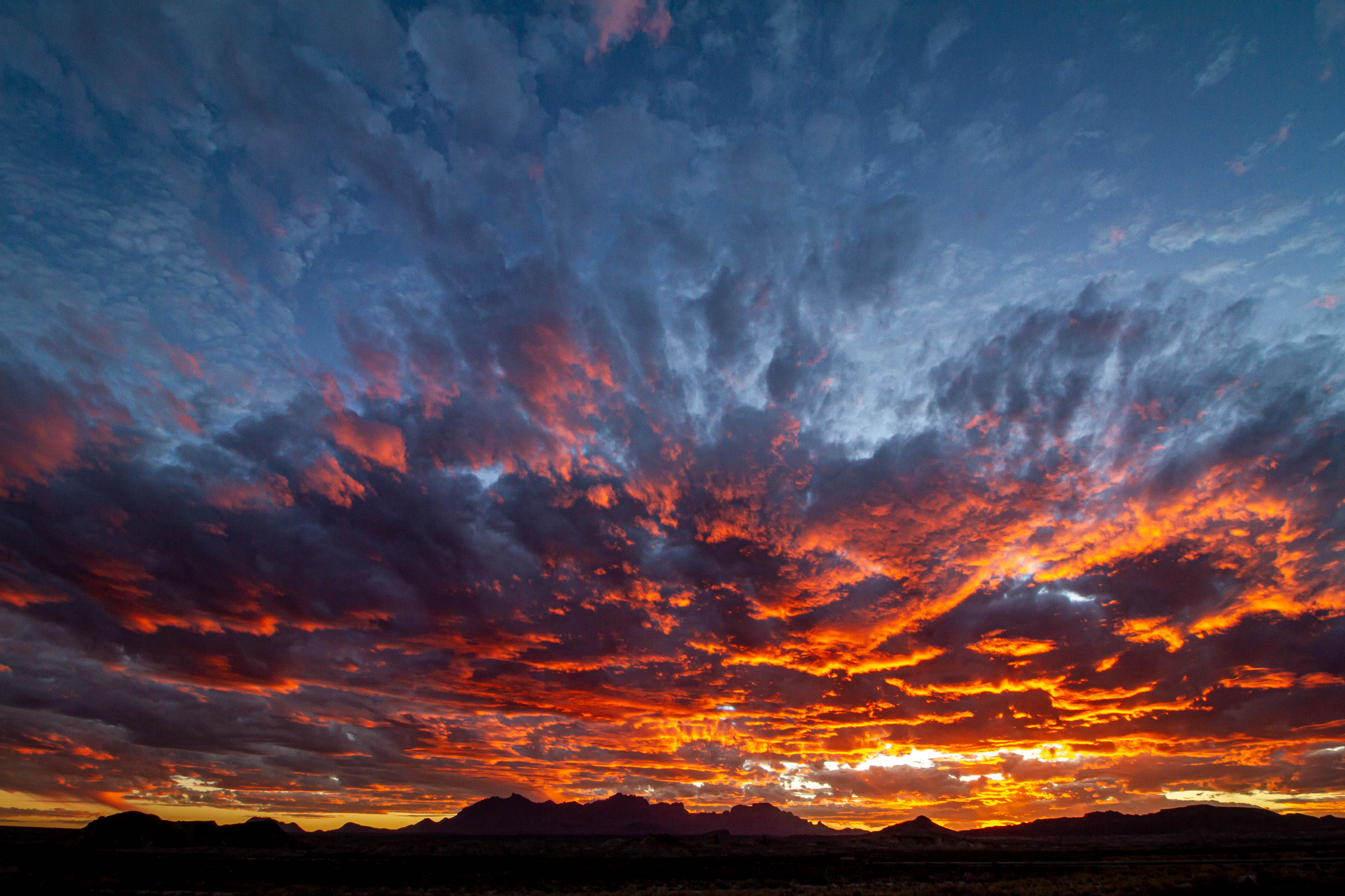 Chisos Mountains sit under an orange sunset